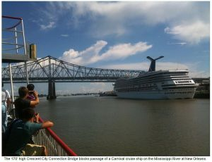 The 170' high Crescent City Connection Bridge blocks passage of a Carnival cruise ship on the Mississippi River at New Orleans